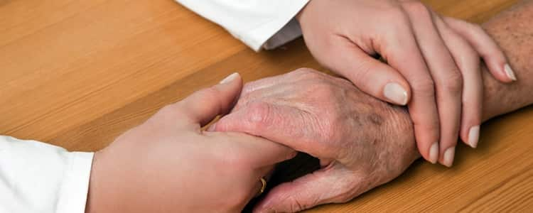 hand-of-a-nurse-and-an-old-man
