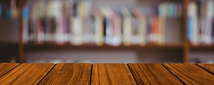 wooden-table-with-library-background